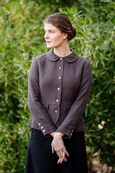Woman wearing dark brown linen jackets with button details