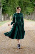 Woman wearing dark green linen midi dress