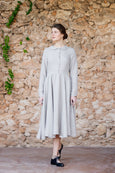Classic dress with long sleeves,peter pan collar and full a-line skirt in natural linen color