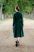 Dark green linen dress with long sleeves, pictured from the back