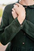 Linen dress in forest green color, up close image of a sleeve