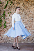 Woman walking in light blue linen skirt in sky blue color
