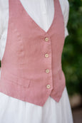 Up front picture of dusty pink linen vest with buttons and ribbon detail at the back
