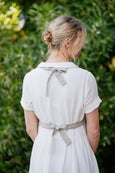 The back detail of linen waistcoat in natural sand color