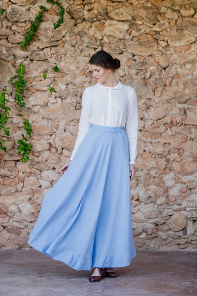 Woman wearing long skirt in sky blue color
