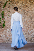 Woman walking in maxi skirt in light blue color