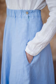 Up close detail of light blue maxi linen skirt and it's pockets