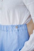 Up close detail of the waist on maxi linen skirt in sky blue color