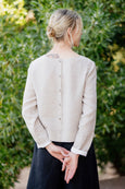 picture of the back of a woman wearing linen shirt in natural linen color