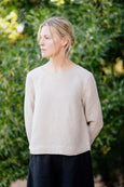 plain linen shirt in natural beige color with long sleeves