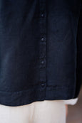 picture of the button detail on the back of women linen shirt in black color