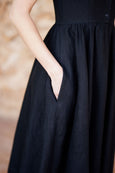 Up close picture of pocket on black linen dress