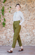 Woman wearing green linen trousers