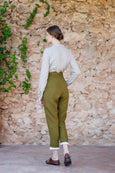 Green linen women trousers with white rolled up bottoms