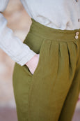 Up close detail of green linen trousers for women