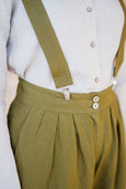 Up close detail of linen suspender belts for women in olive green color