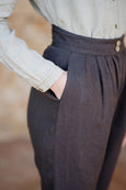Up close picture of pocket detail on linen trousers for women