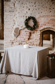 Natural linen tablecloth placed on a table, image from the front