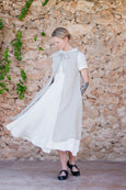 Natural flattering linen apron tied on top of the white dress