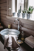 Natural linen towel placed on a sink, image from the front