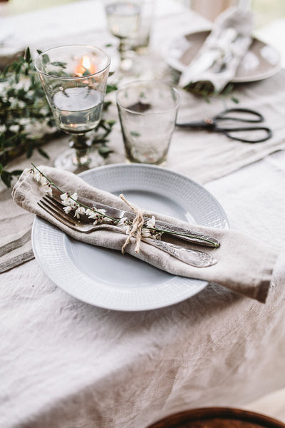 Natural linen napkins placed on a decorated table, image from the front