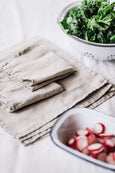 Natural linen napkins placed on a table, image from the front