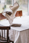 Natural linen towel placed on a table, image from the front