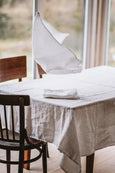 White linen towel placed on a table, image from the front