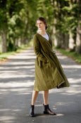 Model wearing rosemary green wrap dress with long sleeves, picture from the front.