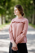 Woman wearing pink color ruffle linen shirt, picture from the front