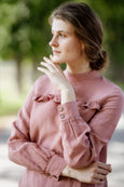 Model wearing pink color ruffle linen shirt, image from the front