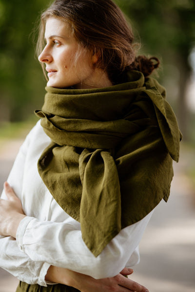 Model wearing rosemary green color shawl, image from the side.