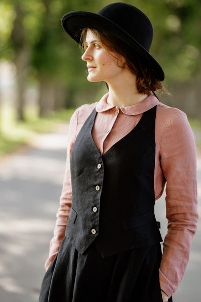 Woman wearing black linen vest, image from the front