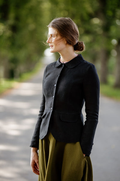 Woman wearing black classic linen jacket, image from the front