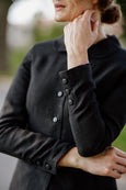 Woman wearing black classic linen jacket, up close image from the front
