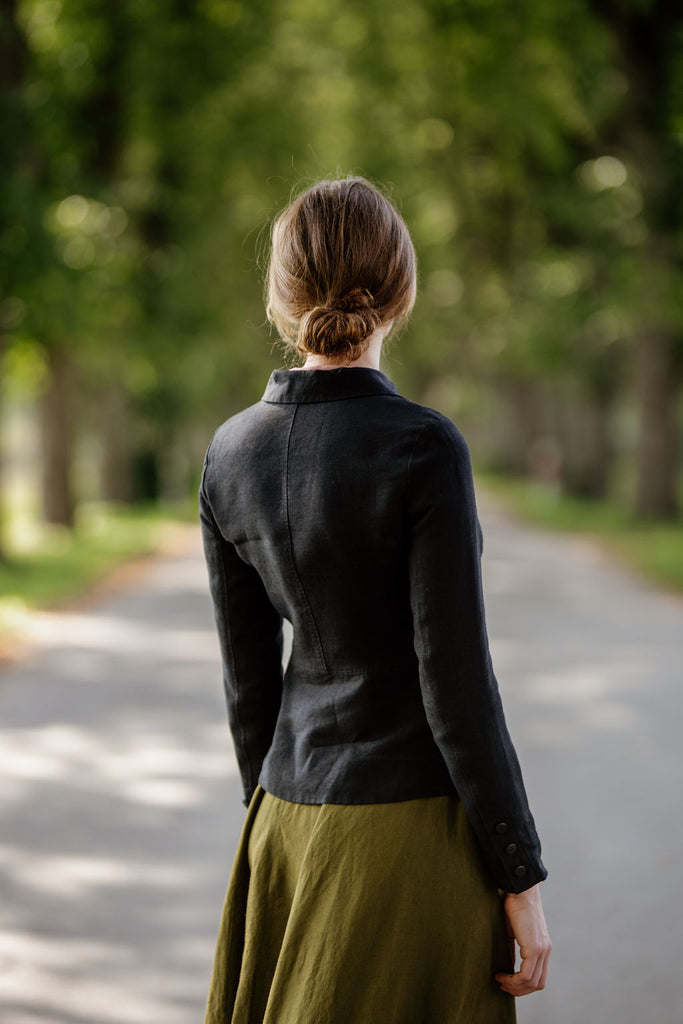 Woman wearing black classic linen jacket, image from the back