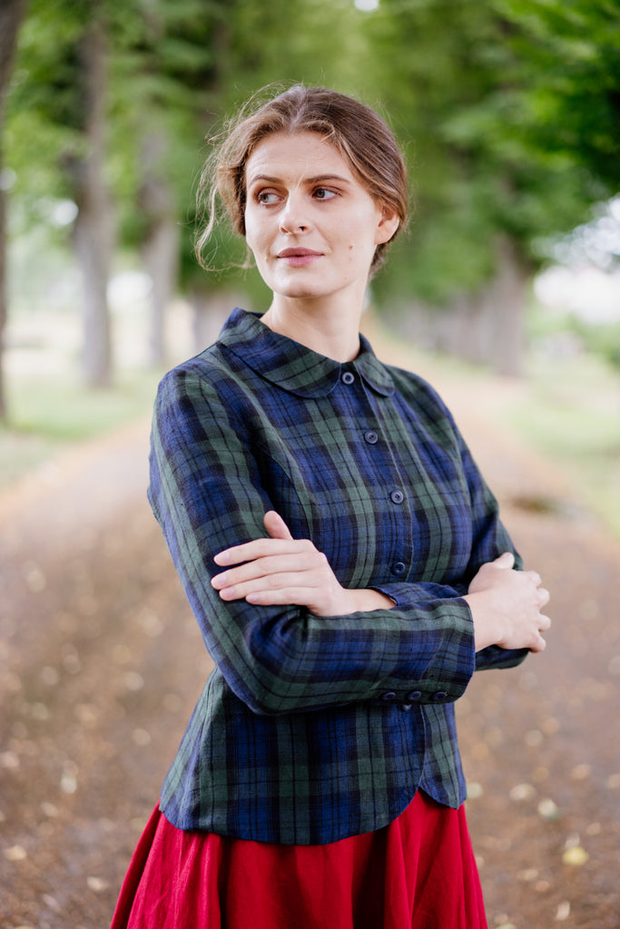 Woman in plaid linen jacket with Peter Pan collar