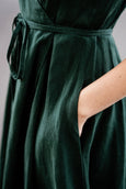 Green linen midi dress with pockets and waist belt, up close image of a pocket