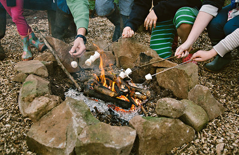 Toasting marshmallows on the campfire - Penhein Glamping