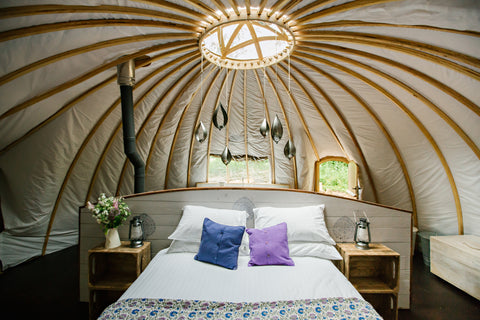 Inside an alachigh tent at Penhein Glamping
