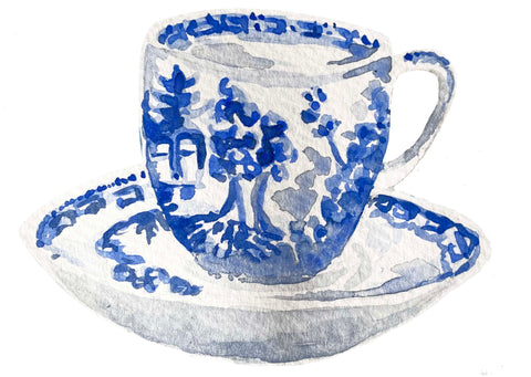 Willow pattern cup and saucer