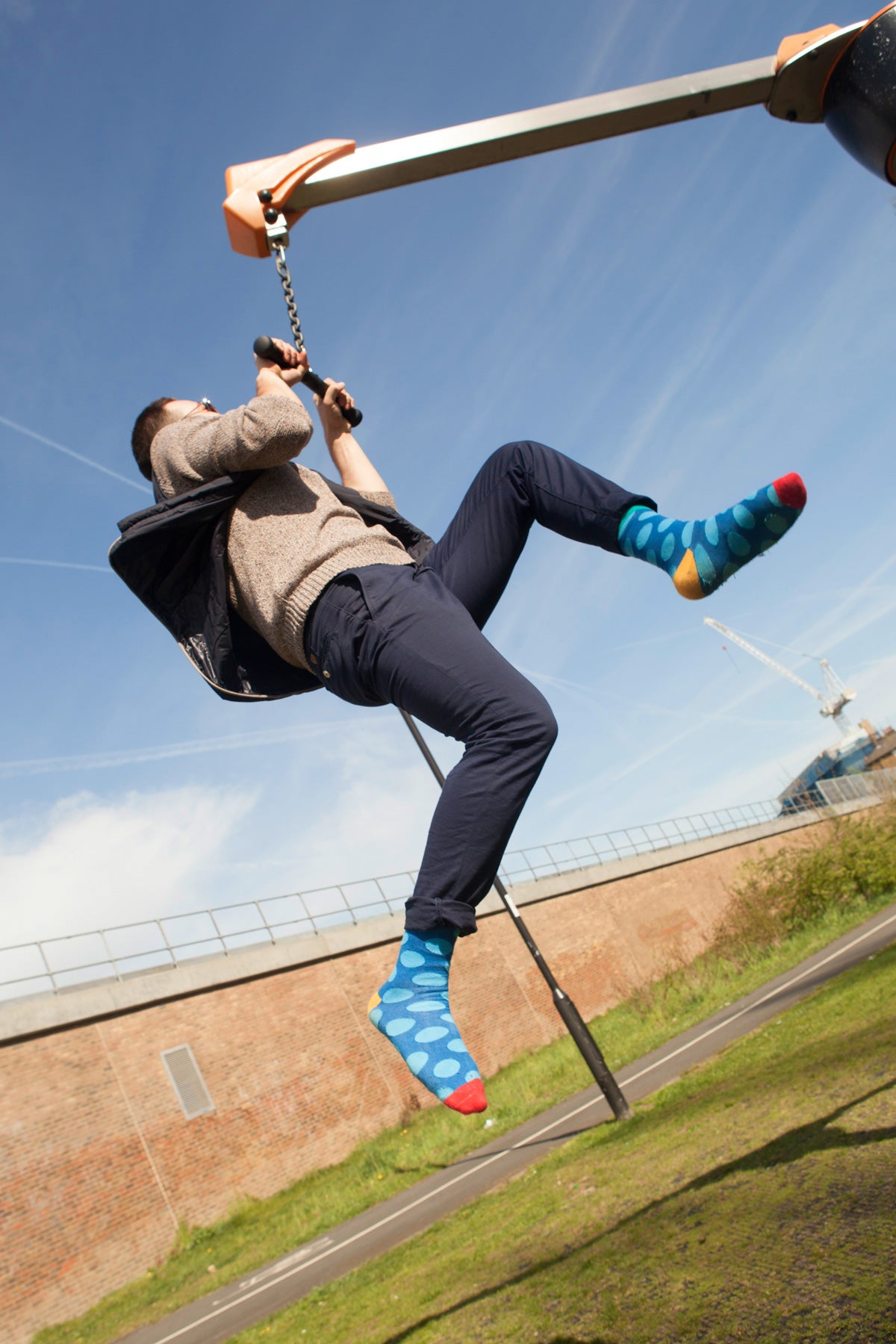Jumping man wearing colorful socks