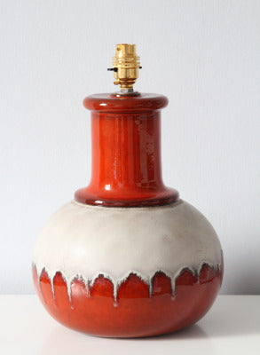 An unusual red and off white ceramic lampbase