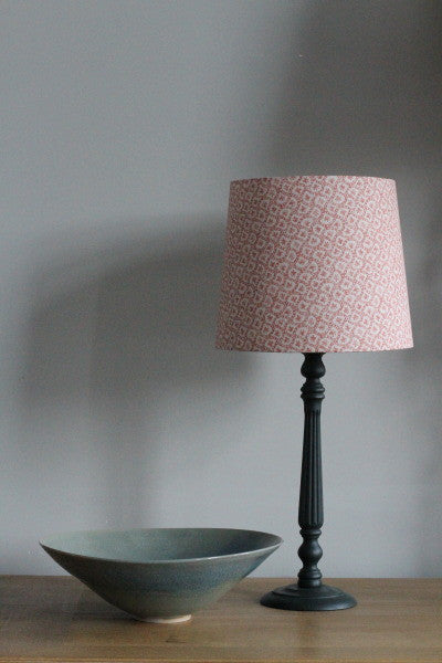 Our classic table lamp in four colours