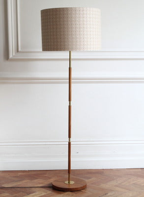 Smart standard lamp with a alternating wood and brass stem SOLD