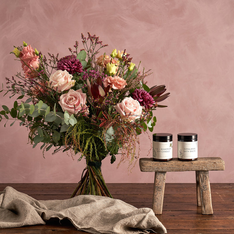 Gift set: Flowers including handmade candle, bath salts and seasonal bouquet