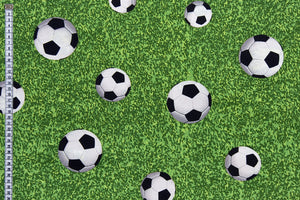 Football Fabric - Footballs on a Grass Background