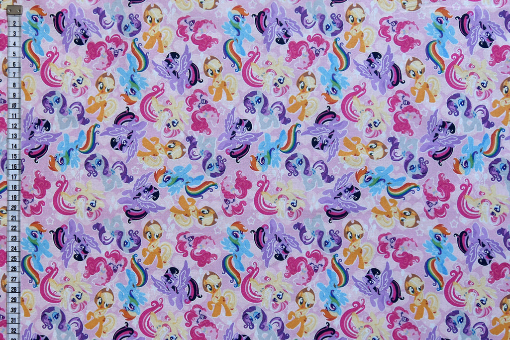 Colourful My Little Pony Fabric - Friends on a Pink Background.