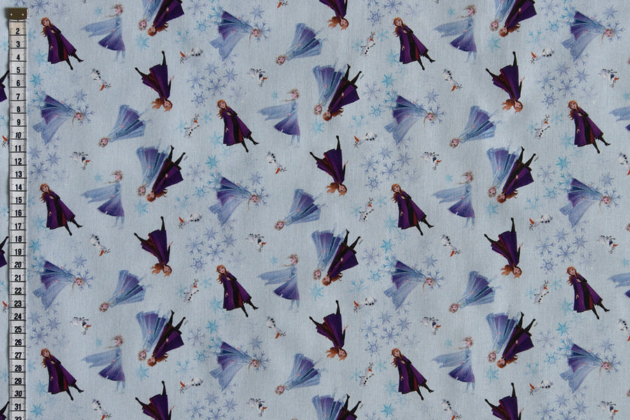 Disney Frozen Fabric - Sisters Elsa & Anna. With Olaf and Snowflakes on a Pale Blue Background. 100% Cotton.