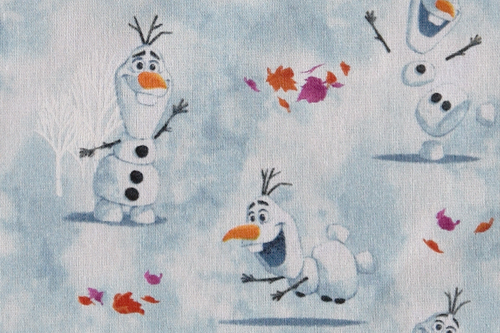 Disney Frozen Fabric - Olaf Plays. Pale Blue Background. 100% Cotton by Camelot.